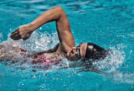 Female swimming front crawl in the pool